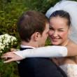Bride hugging groom — Stock Photo
