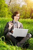 Business man with a laptop on the grass field — Foto Stock