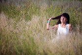 Happy girl in the grass — Stock Photo