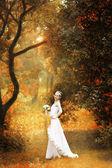 Bride on autumn forest — Stock Photo