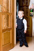 Boy opened the door — Stock Photo