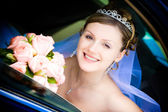 Portrait of the bride in the wedding car — Stock Photo
