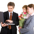 Family looking into the screen of laptop — Stock Photo #40145077