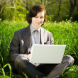 Man with laptop outdoors — Stock Photo #40145221