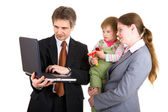 Family looking into the screen of laptop — Stockfoto