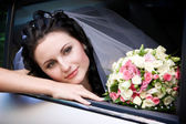 Portrait in the wedding car — Stock Photo