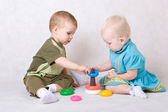 Little girl and boy playing in the constructor — Stock Photo