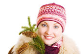 Girl with a branch of fur tree — Stock Photo