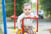 Child on the swing — Stock Photo
