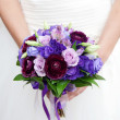 Hands on wedding bouquet — Stock Photo