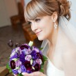 Stock Photo: Young bride with flower
