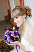 Young bride with flower — Stock Photo