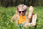 Small barefooted girl in grass — Stock Photo