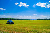 Landscape with a car — 图库照片