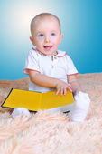 Baby and book — Stock Photo