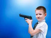 Boy with gun — Stock Photo