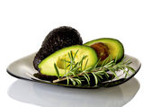 Avocado and rosemary — Stock Photo
