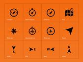 Kompas ikony na pomarańczowym tle. — Wektor stockowy