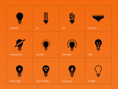 Light bulb lamp icons on orange background. — Stock Vector