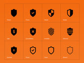 Shield icons on orange background. — Vettoriale Stock
