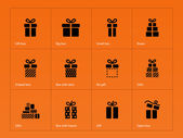 Gift icons on orange background. — Stock Vector