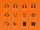Headphones icons on orange background. — Stock Vector