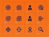 Target icons on orange background. — Stock Vector