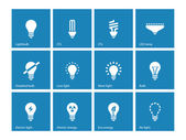 Light bulb and CFL lamp icons on blue background. — Stock Vector