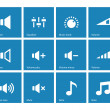 Speaker icons on blue background. Volume control. — Stock Vector #40435801