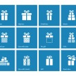 Gift box icons on blue background. — Stock Vector #40437791