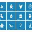 Christmas icons on blue background. — Stockvektor