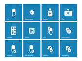 Pills and capsules icons on blue background. — Stock Vector