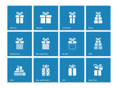 Gift box icons on blue background. — Stock Vector