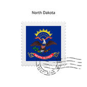 State of North Dakota flag postage stamp. — Stockvector