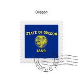State of Oregon flag postage stamp. — Vector de stock