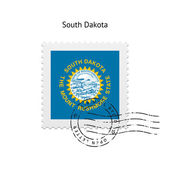 State of South Dakota flag postage stamp. — Stock Vector