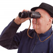 Man looking in the distance with a pair of binoculars — Stock Photo