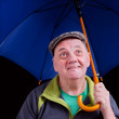 Stock Photo: Man with blue umbrella
