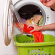 Woman came out of the laundry washing machine — Stock Photo