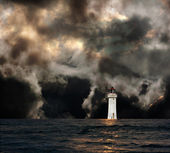 White lighthouse with dramatic storm clouds — Stock Photo
