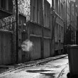 Stock Photo: Dark mysterious alleyway on a rainy day