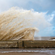 Huge waves crashing onto promenade — Stock Photo #21033137