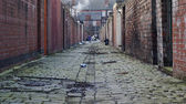 Dirty back street alley — Stock Photo