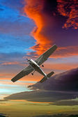 Small airplane against a stormy sky — Stock Photo