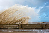 Huge waves crashing onto promenade — Stock Photo