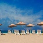 Sunloungers on an empty beach — Stock Photo