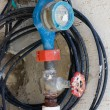 Stock Photo: Old dirty water meter and rusting valve