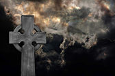 Graveyard cross against storm clouds — Stock Photo