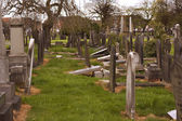 Rows of broken tombstones in a graveyard — Stock Photo
