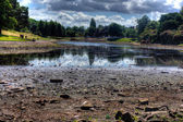 HDR image of a dried up park lake — Stock Photo